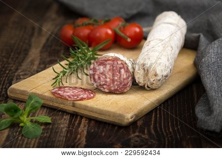 Dried Salami With Rosemary, Basil And Tomatoes.
