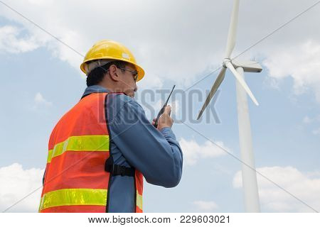 Male Architect Or Engineer Use Two Way Radio
