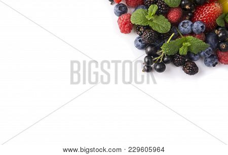 Mix Berries On A White Background. Berries And Fruits At Border Of Image With Copy Space For Text. B