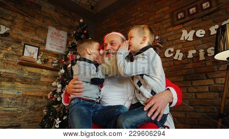 Three Energetic And Cheerful Boys Brothers Indulge, Play  Actively Spend Time Together. Little Guys