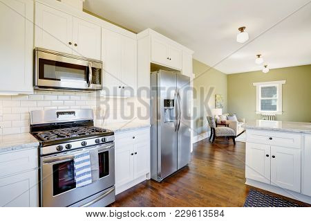 Freshly Updated White And Green Kitchen Room Interior