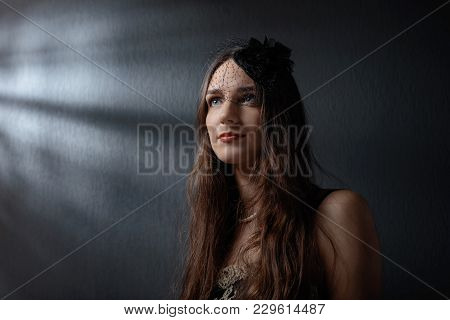 Dramatic Portrait Of A Beautiful Woman In Hat With Veil . Girl With Long Hair And Perfect Makeup . S