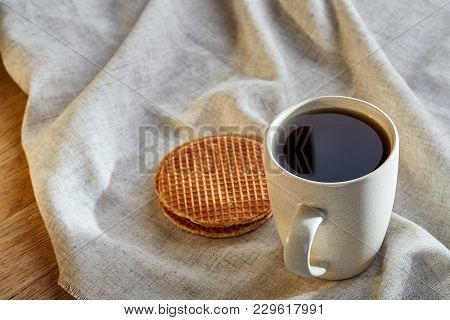 White Porcelain Cup Of Earl Grey Or Black Tea With Chocolate Chips Cookies Decorated With Light Cott