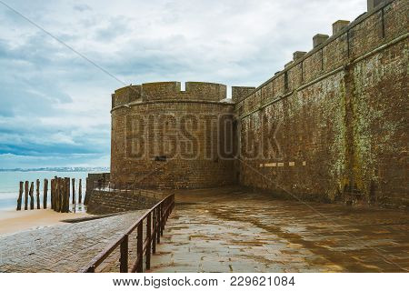 Old Fortification Tower And Walls Around Port City Of Saint-malo, Brittany, France In Rainy Weather