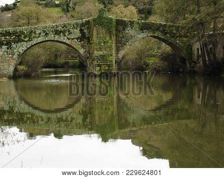 Roman Bridge Over The River Arnoia In Allariz, Galicia. Spain