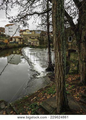 Small Waterfall On The Arnoia River As It Passes Through Allariz, Galicia, Spain