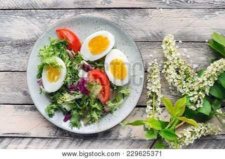 Vegetable Salad With Sliced Boiled Eggs And Fresh Lettuce And Rucola Served On Wooden Table. Top Vie