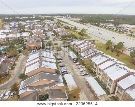 Aerial View Snow Covered Apartment Complex Building In Texas, America
