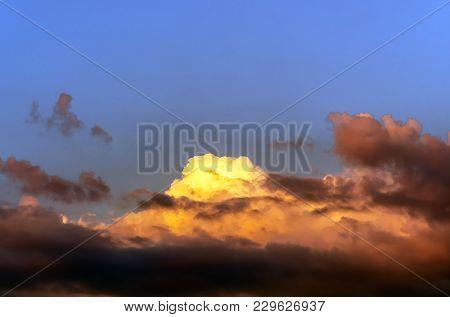 large cumulus clouds, storm clouds in blue sky closeup, large thunderclouds, clouds in clear sky poster
