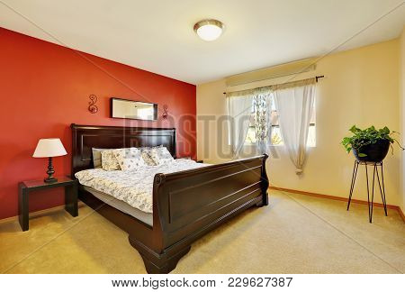 Chic Master Suite With Red Accent Wall