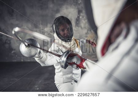 Two Women Fencing