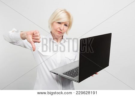 A Picture Of Mature Lady With New Laptop. She Has Tested It And Admitted The Laptop Is Bad. That's W