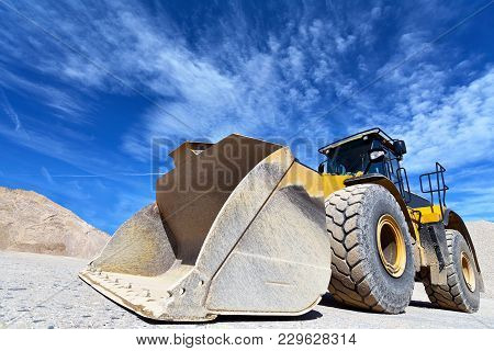 Heavy Construction Machine In Open-cast Mining - Wheel Loader Transports Gravel In A Gravel Plant