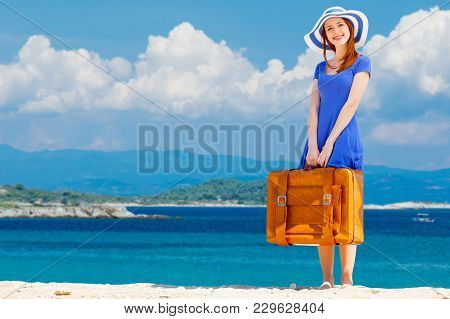 Portrait Of Redhead Girl With Suitcase On The Beach