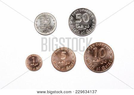 Qatari Coins On A White Background - Dirham