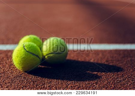 Tennis Balls. Tennis Balls Lying Down On Tennis Court.