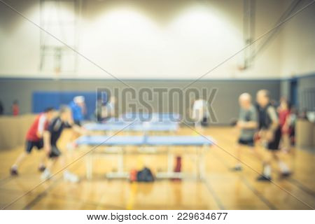 Blurred People Play Table Tennis Indoor At Community Creation Park In America