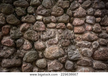 Old Stone Wall Made Up Of Pebbles. Pattern Gray Color Of Modern Style Design Decorative Uneven Round