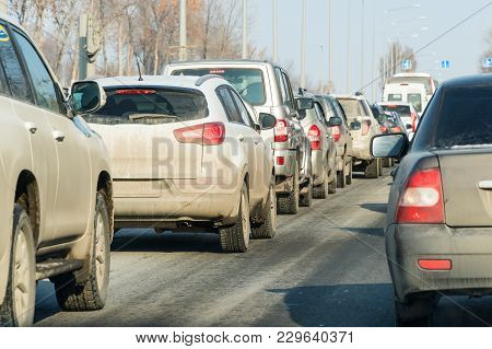 Cars Standing In A Traffic Jam On A City Street