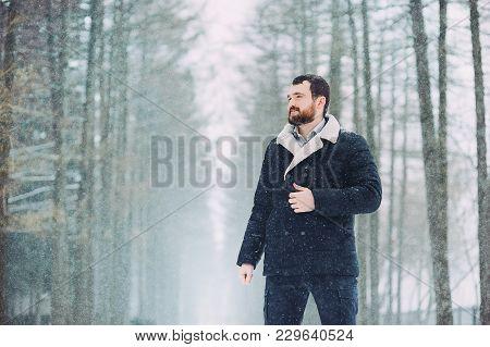 Bearded Guy Walks In A Snowy Forest