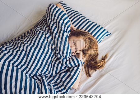 Young Beautiful Woman Woke Up In Bed Close-up.
