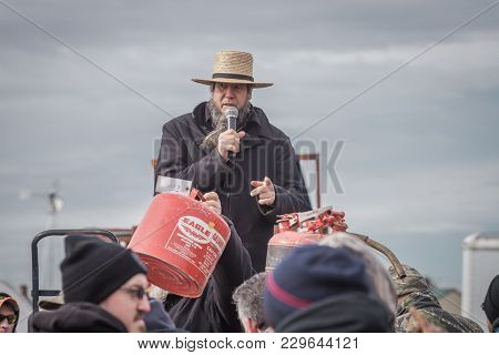 Amish Auctioneer At Bart Mud Sale