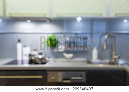 Blurred Modern Kitchen In Grey Colors At Home With Kitchenware