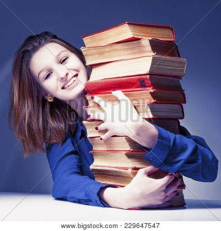 Knowledge Pays Best Investment For Future. Young Student Girl With Books  (education And Self Develo