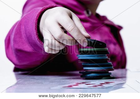 The Concept Of Card Games. Poker Rules: The Little Child Girl Gambler Learning To Play Poker Games.