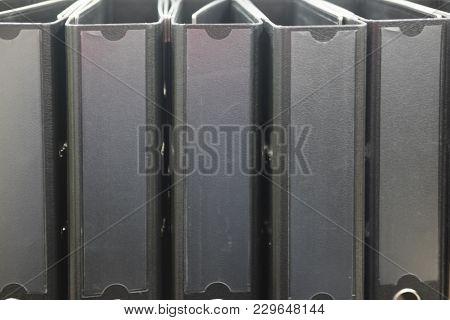 Many Binder Folders On The Shelf In Office
