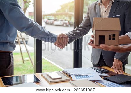 Business Man Shaking Hands During A Meeting In The Office, Signing Of The Real Estate Sale Agreement