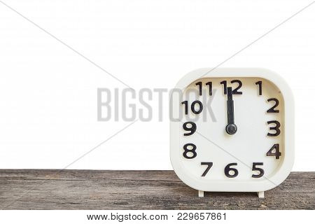 Closeup Square Clock For Decoration Show The Time In 12 O'clock On Old Wood Desk Isolated On White B