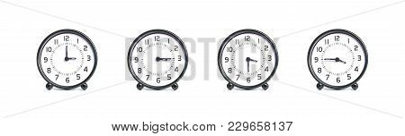 Closeup Group Of Alarm Clock For Decoration Show The Time In 3 , 3:15 , 3:30 , 3:45 P.m. Isolated On