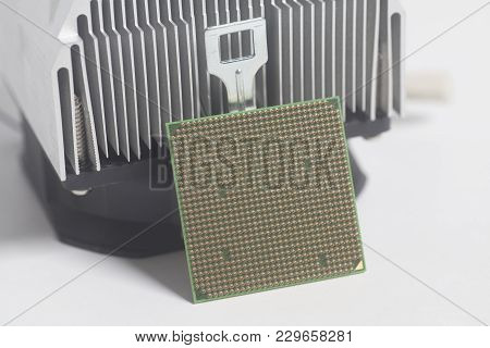 Central Processing Unit Cpu Microchip With Metal Cooler On White Background
