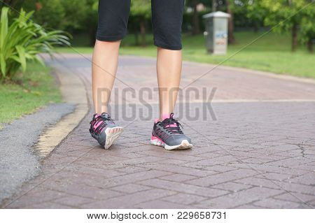 Sporty Woman Ankle Sprain While Jogging Or Running At Park.
