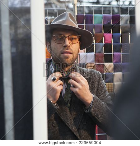London - August 27, 2016: Salesman Of Ties On The Design Market Spitalfield Shows How To Tie A Bow T