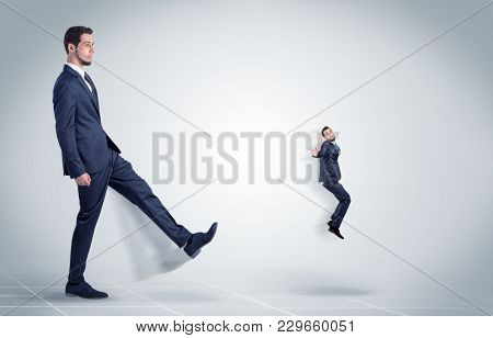 Young businessman fired cruel and aggressive by his boss with white background