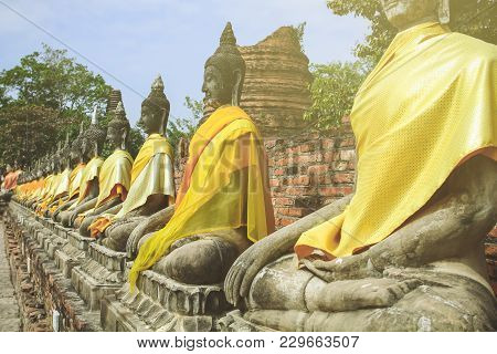 Contra Light Sitting Buddhas Alley In Ancient City Of Ayutthaya Thailand