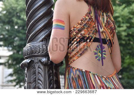 A Female Spectator With The Gay Rainbow Flag Painted On Her Arm At The Gay Pride Parade 2018 In Ital