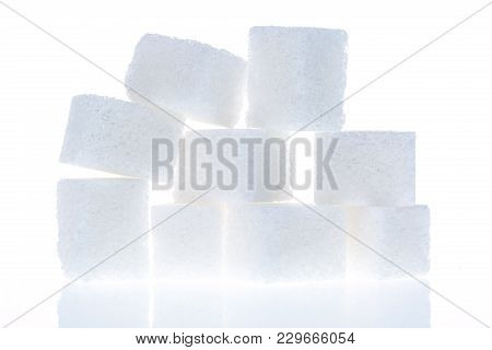 Close Up Of Sugar Cubes Isolated On White Background