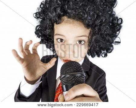 Close-up Of A Little Boy In An Afro Wig In A Business Suit With A Microphone In His Hand, Isolated O
