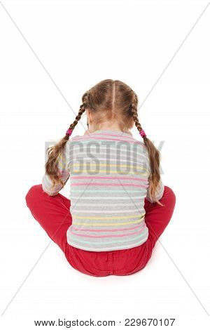 Offended Child Sitting On Floor, Back View, Isolated On White Background