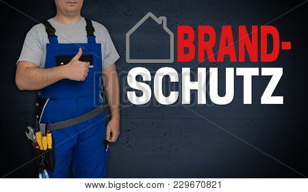 Brandschutz (in German Fire Safety) Concept And Craftsman With Thumbs Up.