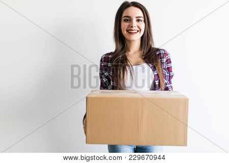 Woman Carrying Moving Boxes. Young Woman Moving House To New Home Holding Cardboard Boxes