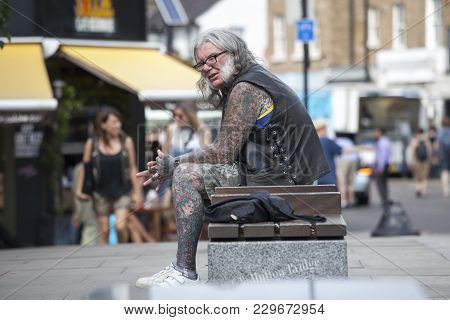 London, England - July 12, 2016 Portrait Of A Middle Age Man With Tattoos, In A Punk Outfit