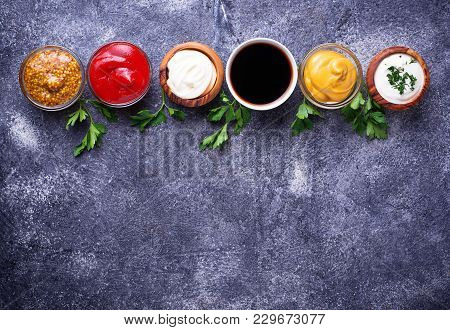 Set Of Different Sauces. Ketchup, Mayonnaise, Mustard, Soy Sauce And Tartar. Top View
