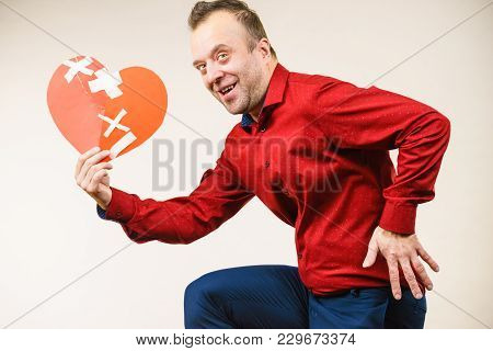 Adult Man Holding Broken Heart Running