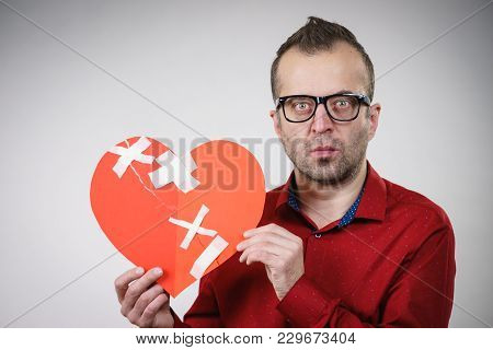 Sad Adult Man Holding Broken Heart