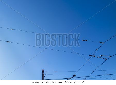 Railroad Overhead Lines Against Clear Blue Sky Contact Wire In Germany