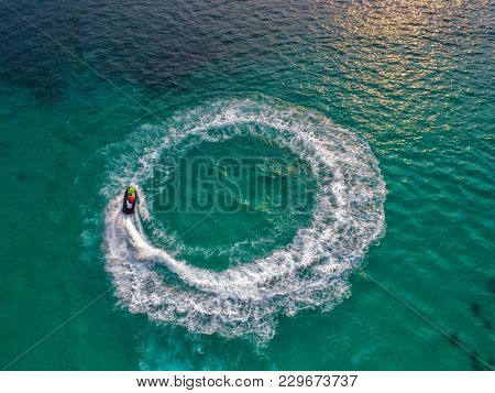 People Are Playing Jet Ski At Sea During The Holidays. And Beautiful Nature Backdrop.